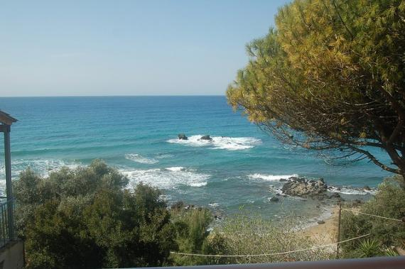 'Pelekas beach - view from our room's balcony at Sun Rock hostel' - Korfu